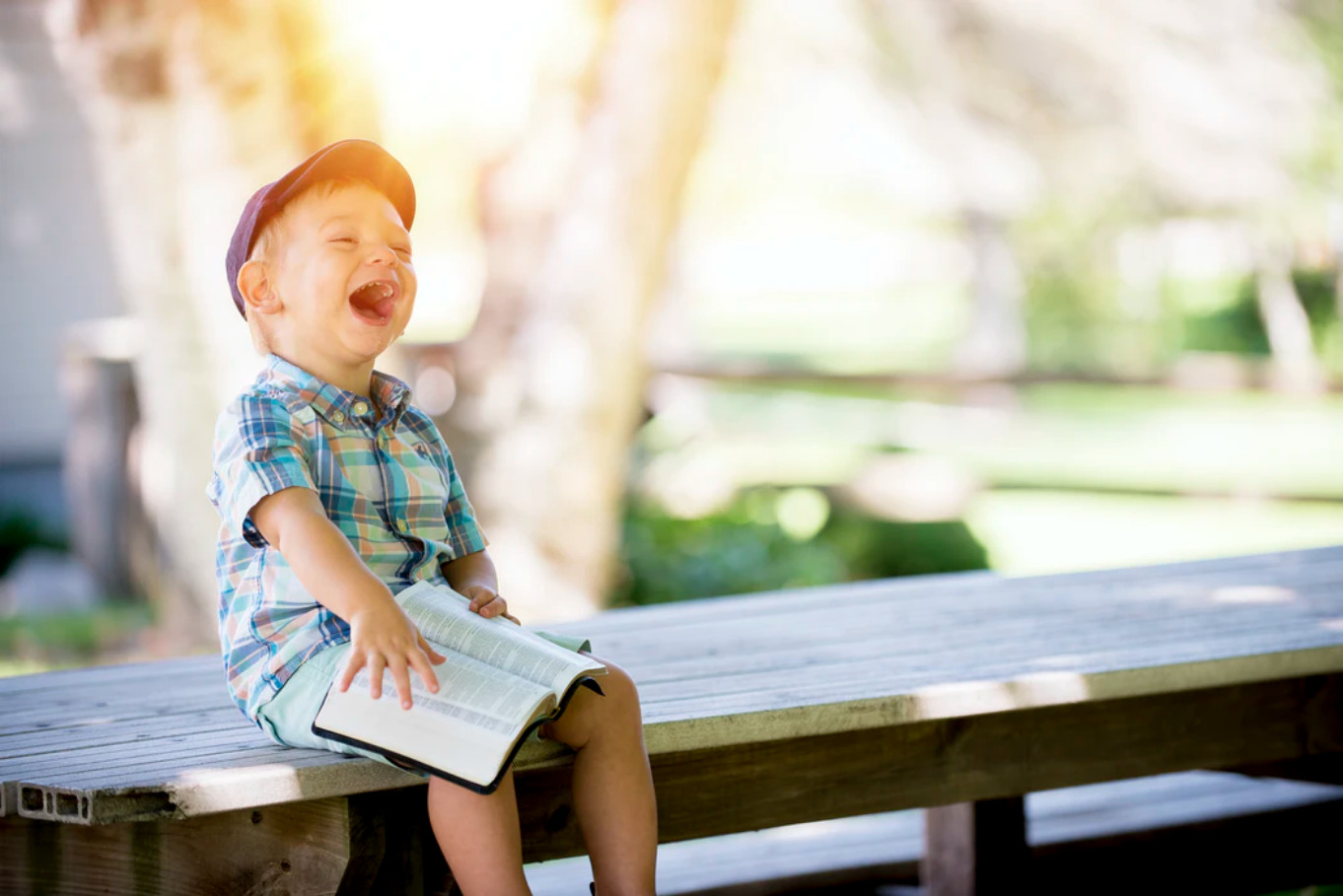 boy-laughing-on-the-bench